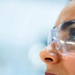 stock image: woman's face wearing clear protective glasses