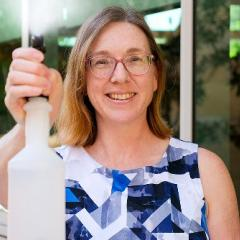 researcher with spray bottle